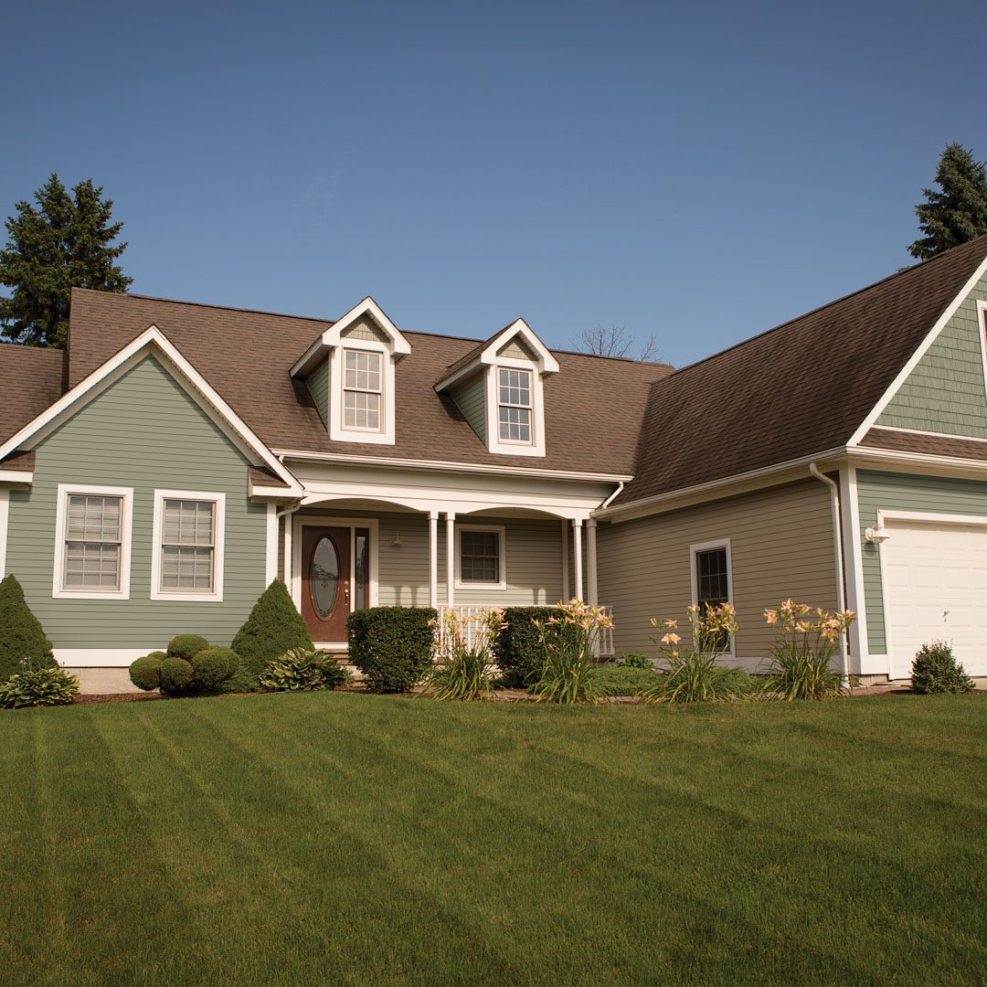 Color stock photo of a single family ranch home in Eastern Michigan during summer.